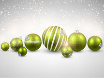 Winter background with green christmas balls. Stock Images