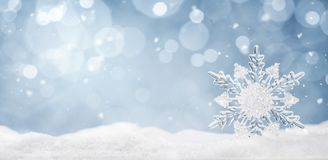 Winter background, crystal snowflake in the snow stock photo