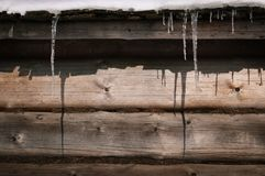 Winter background with framed icicles royalty free stock photo
