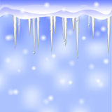 Winter background with icicles Stock Photo