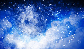 Winter background. Background image with white snowflakes on blue Royalty Free Stock Photo