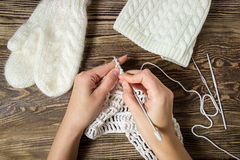 Winter background. Knitting, crochet. White mittens and hat. Royalty Free Stock Photography
