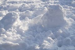 Lots of clean snow illuminated by the sun. Winter background royalty free stock images