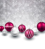 Winter background with magenta christmas balls. Stock Images