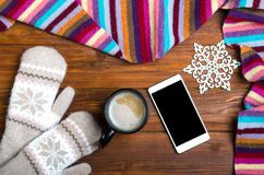 Winter Background: Mittens, A Cup Of Hot Coffee And A Smartphone Stock Images