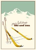 Winter  background. Mountains and ski equipment in the snow Royalty Free Stock Image