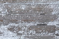 Winter background with natural snow on wooden board Stock Photography
