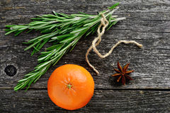 Winter background: rosemary, tangerine and star anise Royalty Free Stock Photo