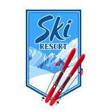 Winter background with skiing equipment. Snowy mountains and fir forest.  Royalty Free Stock Photos