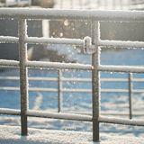 Winter background with snow and blurred bokeh Royalty Free Stock Image