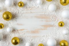 Winter background with snow and Christmas bauble decoration. Minimal Christmas or New Year concept. Flat lay stock image