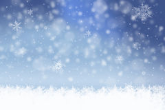 Winter background. With snow flakes and swirls Royalty Free Stock Images