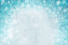 Winter background. With snow flakes and swirls Royalty Free Stock Image