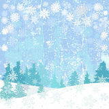Winter background with snowflakes and Christmas trees Royalty Free Stock Image