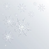 Winter background of snowflakes in white and blue colors Stock Image
