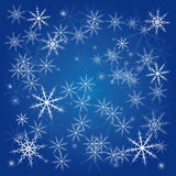 Winter background of snowflakes in white and blue colors Stock Photography