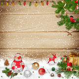 Winter background with a snowman and Christmas decorations Stock Image