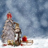 Winter background with a snowman and Christmas trees Stock Image