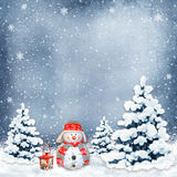 Winter background with a snowman and Christmas trees Stock Photos