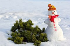 Winter background with a snowman stock photography