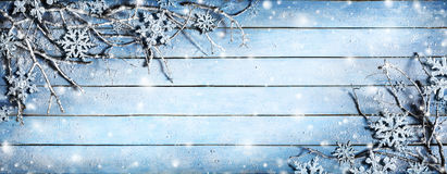 Winter Background - Snowy Branches. On Plank With Snowflakes royalty free stock image