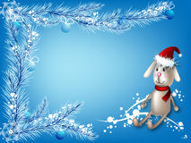 Winter background with the toy hare. Winter blue background with a toy hare and branches of a fir and balls Royalty Free Stock Images