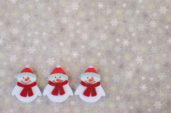Winter background. With a trio of snowmen Royalty Free Stock Photo