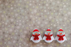 Winter background. With a trio of snowmen Stock Photos