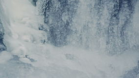 Winter background. Water flowing under transparent ice. Ice surface stock video footage