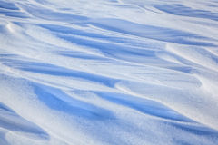 Winter background of white  and  blue  snow Stock Photography