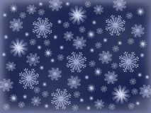 Snowflakes on a blue background royalty free stock photography