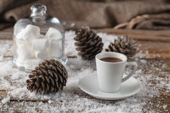 Winter background of wooden old table with  snow and mug Stock Image
