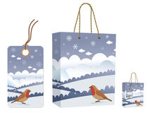 Winter bag and tag set. Winter bag and tag gift set with snow scene and robin isolated on white Stock Photos