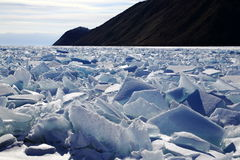 Winter Baikal. Lake Baikal freezes in January, meter crust of ice lasts until the end of March. In February-March, Baikal becomes a Mecca for tourists Stock Photo