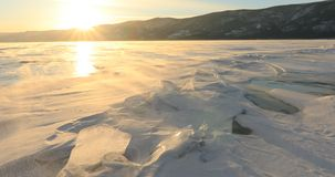 Winter Baikal. Strong wind on the ice, drifting snow. Winter Baikal. Strong wind on the ice, drifting snow stock footage