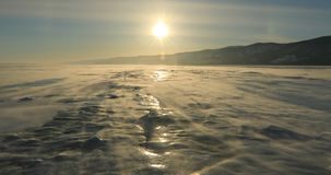 Winter Baikal. Strong wind on the ice, drifting snow. Winter Baikal. Strong wind on the ice, drifting snow stock video footage