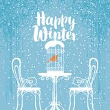 Winter banner with bird in the cage on the table Stock Photo