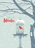 Winter banner with bird in cage under snowy tree Stock Photo