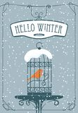 Winter banner with red bird in the cage. Vector winter banner with lettering Hello Winter with a red bird in a cage on the table against the background of Royalty Free Stock Photos