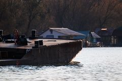 Winter barge at early winter sun, Reflections on the water stock image
