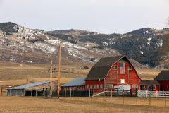 Winter barn with american flag. Stock Photography