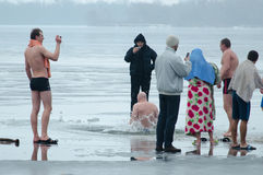 Winter bathing in the river on The Baptism of the Lord's day Stock Photography