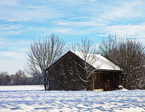 Winter in Bavaria, wooden barn in snow field Stock Photography