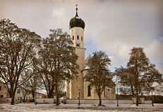 Winter Bavarian landscape, baroque church at sunset Stock Photo