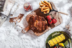 Winter BBQ with rib-eye steak and vegetables Stock Images
