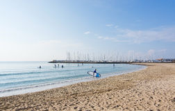 Winter beach Can Pastilla. CAN PASTILLA, MALLORCA, BALEARIC ISLANDS, SPAIN - DECEMBER 13, 2015: Winter beach with surfers and stand up paddlers near marina and Royalty Free Stock Photo