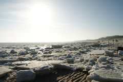 Winter on the beach. Winter day with Ice on a beach in Northern Germany Royalty Free Stock Image