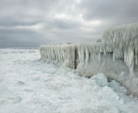 Winter Beach, everything is covered in ice and icicles Stock Photos