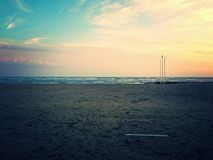 Winter beach in Grado. (Italy), with cold sea and sunset Royalty Free Stock Image