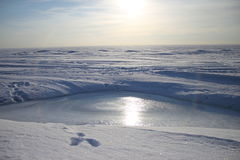 Winter beach. View of the skyline. Winter beach. Skyline views across the frozen ice hole Stock Photo